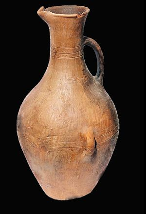 Ingushetia - Pottery: an ancient Ingush vessel with three handles. The side handles used to tie the knots, and the vessel itself is well balanced for an operator to pour water down with one hand. Dzheirakhovski district of Ingushetia.