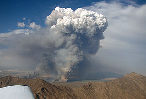 Sierra Estrella - Fire in the Gila River Valley, southwest of Phoenix, (Rainbow Valley over peaks of Sierra Estrella)