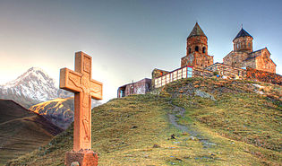 At holy trinity church near Kasbek Mt. (10204235624).jpg