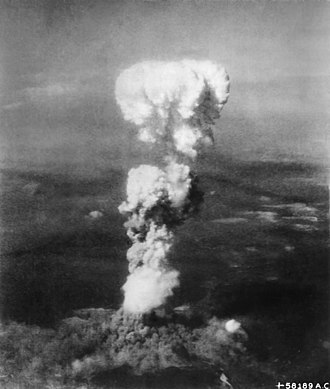 Total war - The mushroom cloud produced by the atomic bombing of the city of Hiroshima during World War II. The bombing was an act of total war.