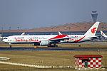 B-2035 - Air China - Boeing 777-39L(ER) - Smiling China Livery - PEK (14388461481).jpg