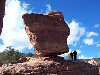 "Boulder - This balancing boulder, ""Balanced Rock"" stands in Garden of the Gods park in Colorado Springs, Colorado, United States."