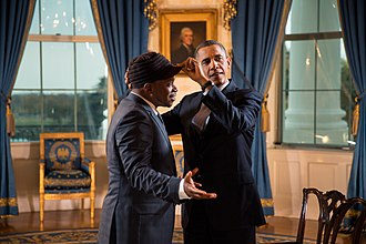 Sway Calloway - President Barack Obama adjusts Calloway's hat after an interview for a Live MTV special at the White House, 2012