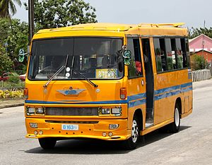 Transport in Barbados - An ACME Hino Midibus in Speightstown, Barbados.