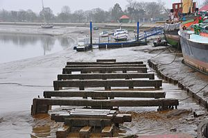 Thames sailing barge - Barge blocks for scraping barnacles and applying anti-fouling paint at Cooks Yard, River Blackwater