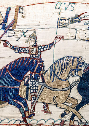 Eustace II, Count of Boulogne - Detail from the Bayeux Tapestry, possible depiction of  Eustace II, with moustaches, inscribed in margin above in Latin: E...TIUS, possibly Latinised form of his name