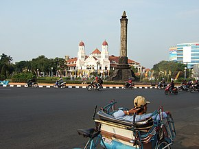 The NIS headquarters on the left and Tugu Muda stone monument, representing the 5 days war in Semarang during Revolution