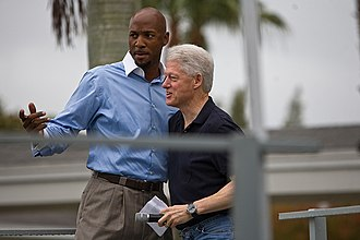 Alonzo Mourning - Alonzo Mourning with former U.S. President Bill Clinton during Clinton Global Initiative University Day of Service at Carrfour Supportive Housing community for formerly homeless families in Miami, Florida.