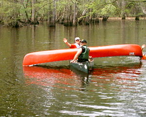 Boy Scout leaders and Scouts (in the water) pr...