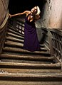 Blond woman on a Purple dress on stairs 01.jpg