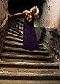 Blond woman on a Purple dress on stairs 01.jpg