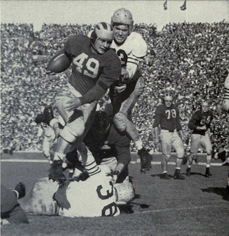Bob Chappuis - Chappuis hurdling an opposing tackler, 1946.