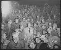 Bob Hope, radio and screen star, sits with men of X Corps, as members of his troupe entertain at Wonsan, Korea. - NARA - 531384.tif