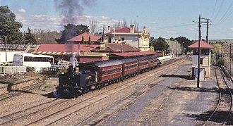 """3801 Limited - SMR18, affectionly known as """"Bob"""", departs Moss Vale with the Cockatoo Run in September 1997"""