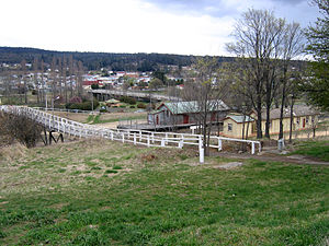 Bombala, New South Wales - Bombala, looking towards the town centre. The footbridge passes over the Bombala railway line. The right most building is the station building, the centre building the goods shed and above that is the bridge over the Bombala River.