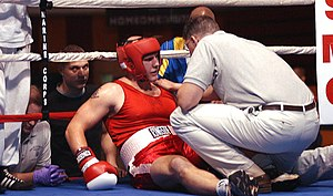 A boxer is knocked down and receives the 10 count.