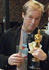 Brad Bird holding the Academy Award for Best Animated Feature
