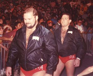 Tully Blanchard - Blanchard (right) with Arn Anderson as The Brain Busters.