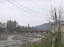 The arch bridge over the Qudyalçay connecting Quba (left) and Qırmızı Qəsəbə (right)