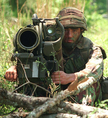 A British Royal Marine from 45 Commando watches for enemy tanks and armoured personnel carriers from behind his anti-armour weapon as part of Combined Joint Task Force Exercise '96. British Royal Marine with anti-tank weapon.jpg