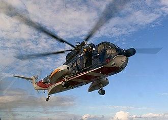 Sikorsky S-61 - A British International Helicopter S-61N lands aboard the USS Vicksburg