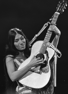 A young woman playing a classical guitar
