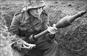 Panzerschreck - A German soldier handling a RPzB. Gr. 4322 HEAT rocket used with the Panzerschreck.