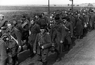 Fall Rot - French prisoners are marched into internment.