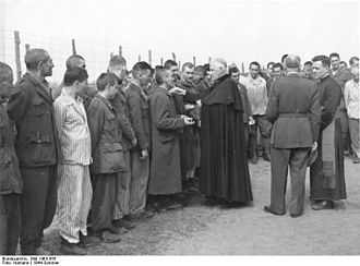 Opilio Rossi - Rossi (right, with officer) visiting a POW camp.