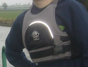 Buoyancy aid - A person wearing a buoyancy aid with a reflective strip
