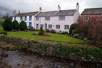 John Peel (huntsman) - Caldbeck cottages, home of the huntsman John Peel. Caldbeck was a stopping place for travellers to whom the monks provided hospitality.