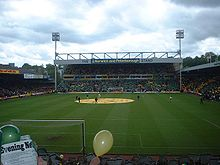 Carrow Road - fans holding yellow or green fliers.jpg
