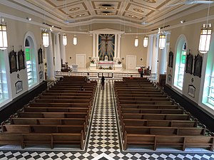 Cathedral of the Good Shepherd - View of the nave after the 2016 restoration. The altar is remodelled, the cathedra was put back to pre-1960 sanctuary remodelling and a new altar rail to match the new style of the sanctuary is installed.