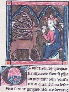 Miniature montrant un cerf marron avec cinq cornes et un pied blanc face à un personnage couronné assis sur un trône.