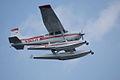 Cessna A185F N363JV Overhead 05 SNFSI FOF 15April2010 (14607358376).jpg