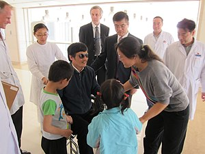 Chen Guangcheng - Chen Guangcheng with his family at a hospital in Beijing, China, on 2 May 2012