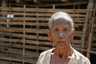 Chin people - Elderly Chin woman in the Lemro River valley, note the facial tattoos