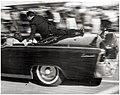 Clint Hill on the limousine.jpg
