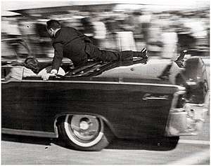 Clint Hill (Secret Service) - Clint Hill on the Presidential limousine moments after Kennedy's assassination.
