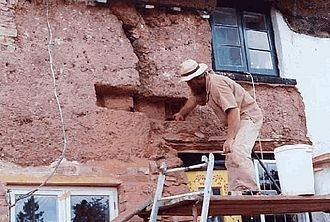 Cob (material) - 'Cob stitch' repair on old traditional cob cottage in Devon, England