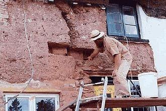 Cob (material) - 'Cob stitch' repair on old traditional cob cottage in Devon, England