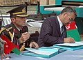 Col. Can Bolat and Col. Qussimi, Assistant to Minister Jawhari sign documents (4699293195).jpg