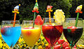 Colorful drinks with harlequin swizzle sticks.jpg