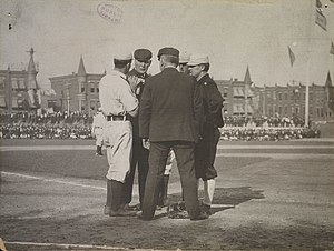 Hank O'Day - During the 1905 World Series, O'Day (back left) confers with plate umpire Jack Sheridan, New York manager John McGraw (right) and two Philadelphia players.