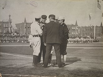 John McGraw - McGraw discusses an issue with an umpire and two members of the Philadelphia Athletics.