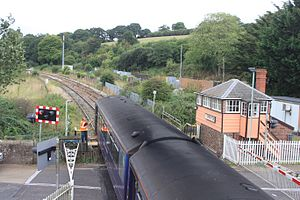 Crediton railway station - A train driver collects the single-line token at the signal box in 2016