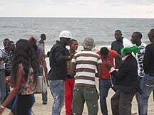 Gabon-Demographics-Crowd on Beach in Gabon