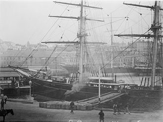 Cutty Sark - Cutty Sark moored in a port, possibly Sydney. Another clipper can be seen in the background