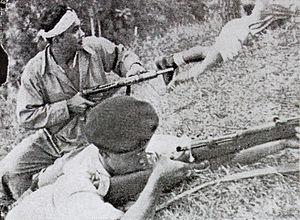 Darah dan Doa - The Siliwangi Division in combat, in a scene from the film.