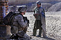 Defense.gov News Photo 101224-M-0901H-140 - U.S. Marine Corps Cpl. Patrick Kelley speaks with an Afghan boy while providing security during an inspection of a new school being built in.jpg